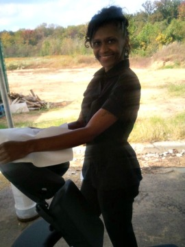 Trevecca Douthet, LMT Volunteering her Chair Massage Services at the Spring 2012 build.